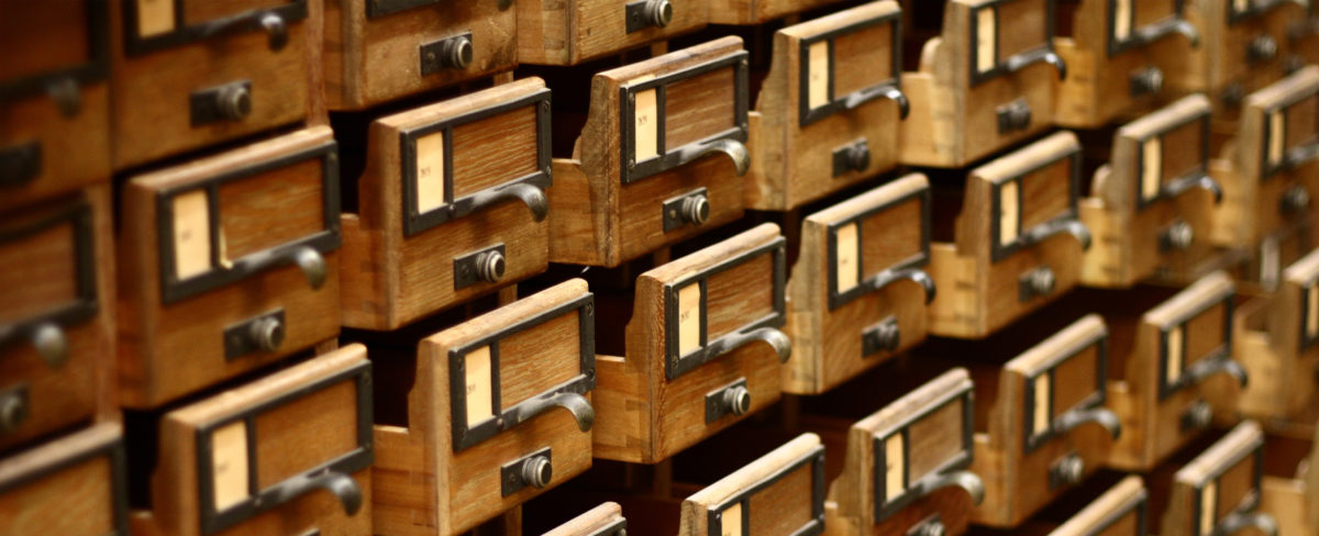 empty card catalog with drawers slightly open